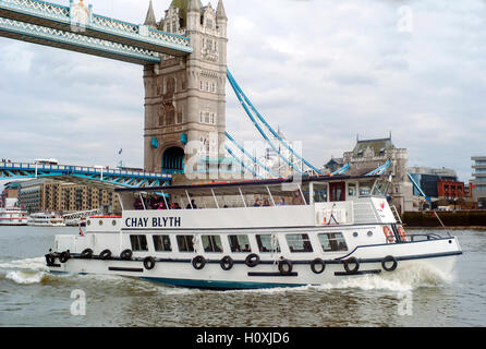 Chay Blyth Thames tourist river boat  passing under Tower bridge London - Stock Photo
