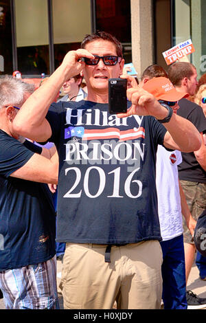 Pro-Trump supporter wearing a Lock -Her-Up Anti-Hillary t-shirt in Asheville, NC - Stock Photo