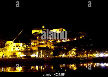 Coimbra seen from Santa Clara bridge, in Portugal - Stock Photo