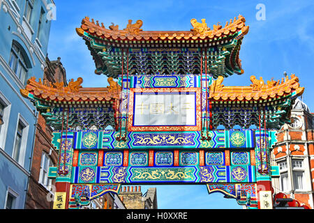 New 2016 China Town colourful gate across Wardour Street marking one of the entrances to the Chinatown area of London - Stock Photo
