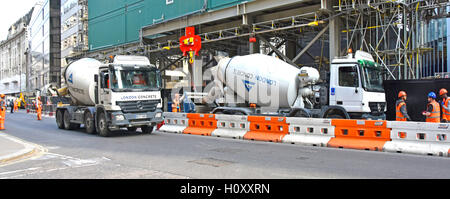 Ready mixed cement concrete truck City of London street partly segregated for construction site delivery trucks - Stock Photo