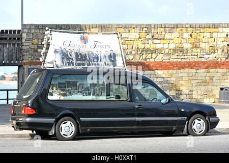 Portsmouth England UK Hearse with adverts to promote events that can be hosted at the adjacent Tudor 'Square Tower' - Stock Photo