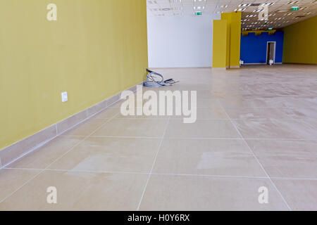 New empty finished modern large showroom at business center. - Stock Photo