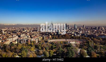 Panoramic aerial view of Milan from Branca tower,  with a backdrop of the Alps - Stock Photo