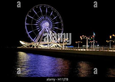 View of Baku Ferris Wheel, also known as the Baku Eye on Baku Boulevard in the Seaside National Park of Baku capital - Stock Photo