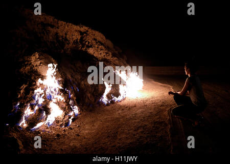 Natural gas erupting from the earth and burning in Yanar Dag also called the Burning Hill on a hillside in the Absheron - Stock Photo
