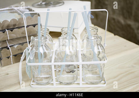 Empty glass milk bottles in grocery store, sale - Stock Photo