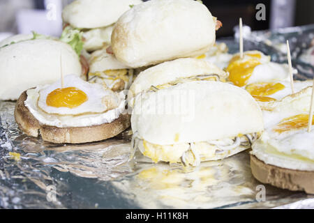 Egg sandwich with goat cheese in restaurant, food - Stock Photo