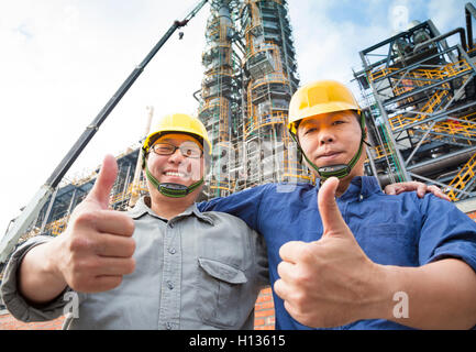two happy  Factory workers  with thumb up - Stock Photo