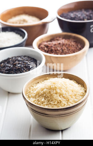 Different rice varieties in bowl. - Stock Photo