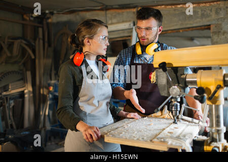 Interaction of woodworkers - Stock Photo