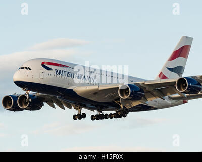 British Airways plane Airbus A380 wide-body superjumbo airplane aeroplane airborne short final approach for landing - Stock Photo
