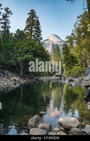 Mountain reflected in Merced River, North Dome, John Muir Trail, Yosemite Valley, Yosemite National Park - Stock Photo