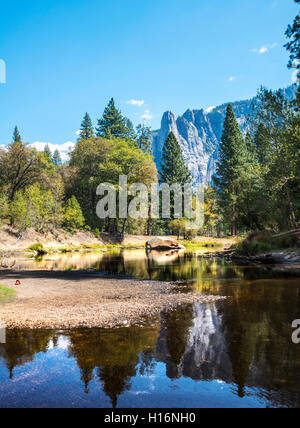 Mountains reflected in water, Merced River, Yosemite Valley, Yosemite National Park, UNESCO World Heritage Site, - Stock Photo