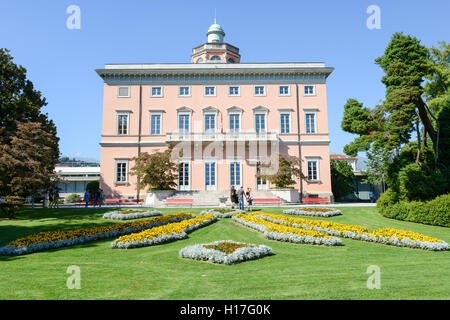 Lugano, Switzerland - 25 august 2016: people walking in front of the villa on Ciani botanical park in the center - Stock Photo
