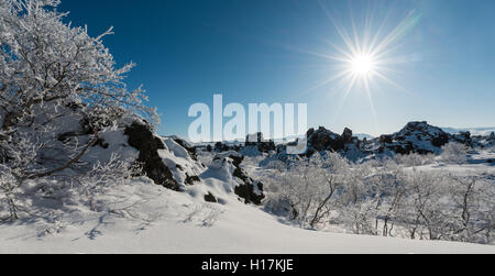 Sunshine, snowy landscape, lava field covered in snow, Krafla volcanic system, Dimmuborgir National Park, Mývatn, - Stock Photo