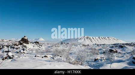 Snowy landscape, lava field covered in snow, Krafla volcanic system, Dimmuborgir National Park, Mývatn, Iceland - Stock Photo