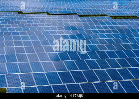 Many Photovoltaik solar panels are part of a big solar powerplant, Buckendorf, Bavaria, Germany - Stock Photo