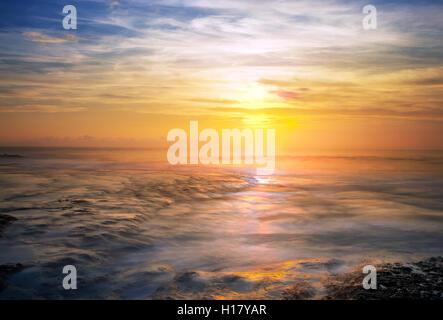 Sunset iat Tanah Lot Bali Indonesia - Stock Photo
