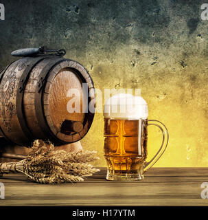 Barrel on stand and mug of beer tinted in yellow and blue - Stock Photo