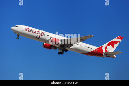 Air Canada Rouge Boeing 767-300ER taking off from El Prat Airport in Barcelona, Spain. - Stock Photo