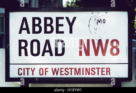 LONDON, UK - MAY 6TH 2013: Abbey Road sign photographed in London. Abbey Road is famous for its crossing featured - Stock Photo