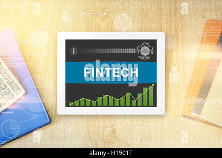 fintech or financial technology word on tablet with soft light vintage effect - Stock Photo