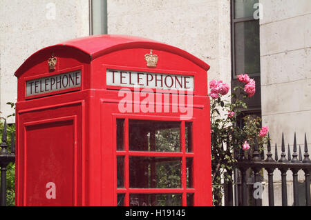 LONDON, UK - 6TH JULY 2013: The iconic red phone booth photographed in London, UK on 6th July 2013. - Stock Photo