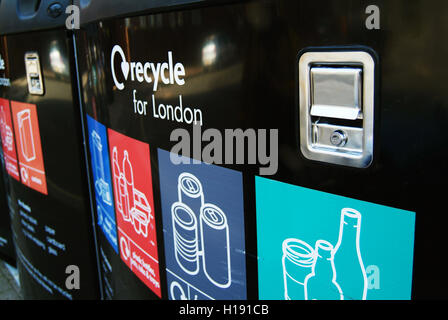 LONDON, UK - MAY 5TH: Close-up of a row of large black recycling bins in London.  London, United Kingdom - 5th May - Stock Photo