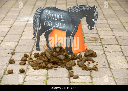 Horse manure for sale sign. Manure for sale sign in a stable yard - Stock Photo