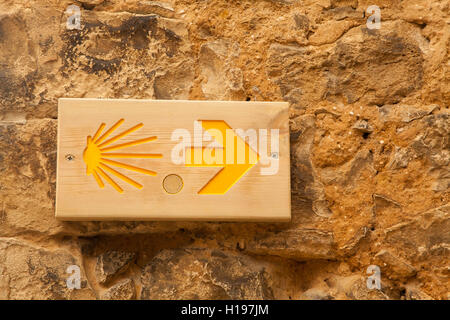 Way markers and sign posts to help walkers and pilgrims on their journey along the Camino de Santiago the way of - Stock Photo