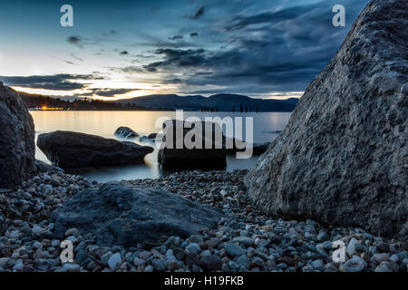 A low view of the sunset over Loch Lomond and Trossachs national park Scotland - Stock Photo