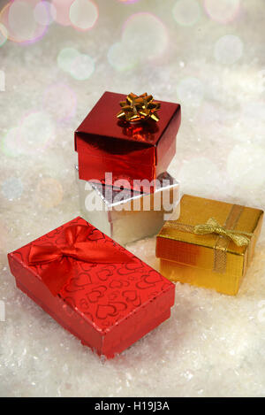 Colored boxes with gifts on a white background