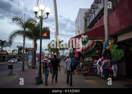 Tijuana, BAJA CALIFORNIA, MEXICO. 19th Sep, 2016. Haitian migrants seeking to enter the United States walk downtown - Stock Photo