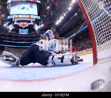 TORONTO, CANADA – SEPTEMBER 22, 2016: Russia's Ivan Telegin (R) scores past Finland's goalie Tuukka Rask in their - Stock Photo