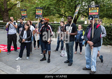 London, UK. 23rd Sep, 2016. Activists from Stand Up To Racism and Black Lives Matter show solidarity with Charlotte, - Stock Photo