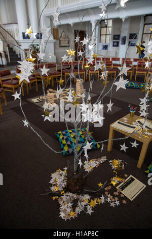 London, UK. 23rd Sep, 2016. A tree for hanging 'stars of hope' at an exhibition at Hinde Street Methodist Church - Stock Photo