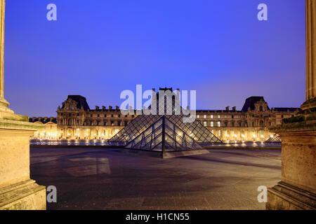 PARIS - January 8th 2012 : Closeup of Louvre Pyramid shined at dusk in Paris, France. Louvre is the biggest Museum - Stock Photo