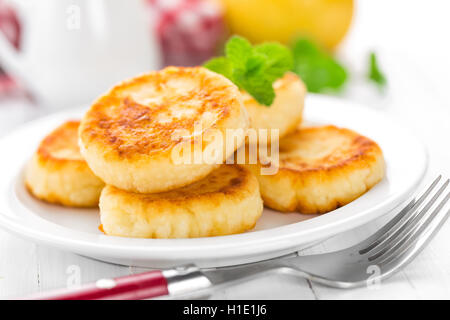 cottage cheese pancakes, syrniki - Stock Photo