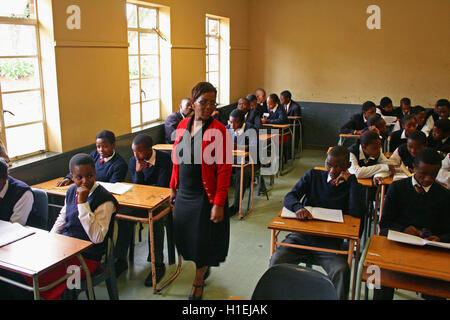 School teacher with school children in classroom, St Mark's School, Mbabane, Hhohho, Kingdom of Swaziland - Stock Photo