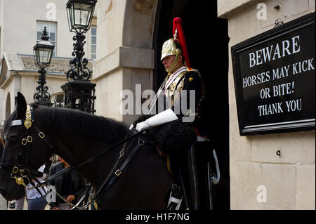Mounted trooper from the Household Cavalry Mounted Regiment on duty outside the Household Guards Museum. London, - Stock Photo