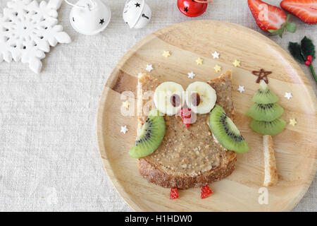 Fun holidays owl toast with fruit, food art breakfast for kids - Stock Photo