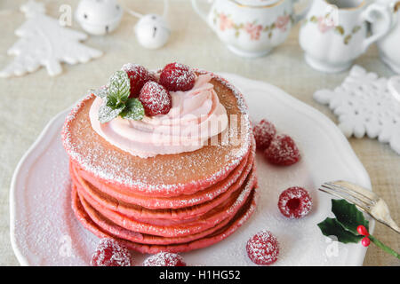 Red velvet pancakes breakfast with Christmas decoration - Stock Photo