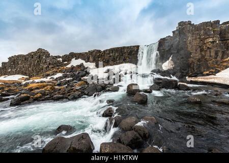 Öxarárfoss Waterfall, River Öxará, Thingvellir National Park, Golden Circle, Southern Region, Iceland - Stock Photo