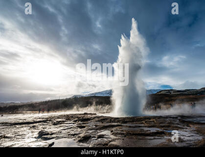 Strokkur geyser erupting, hot springs, geothermal area in Haukadalur Valley, Golden Circle, Southern Region, Iceland - Stock Photo