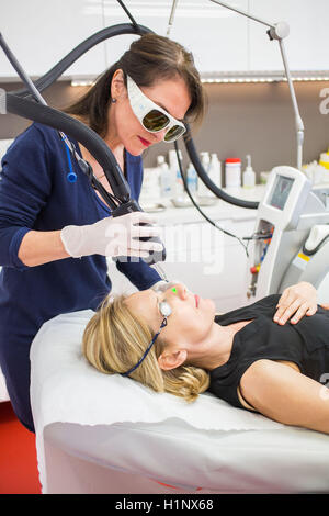 Vascular laser used in treatment of rosacea and varicosity - Stock Photo