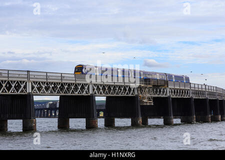 Tay Rail Bridge, north end, Dundee, Scotland, with a Scotrail diesel multiple unit  (DMU) crossing. - Stock Photo
