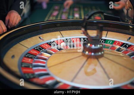 Roulette wheel in casino - lucky seven wins - Stock Photo