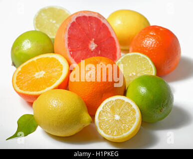 Various citrus fruits over white background - Stock Photo