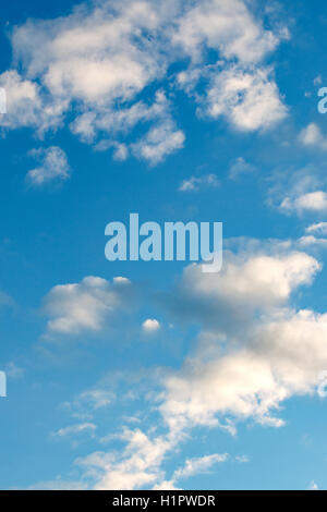 a lot of clouds in the blue sky - Stock Photo
